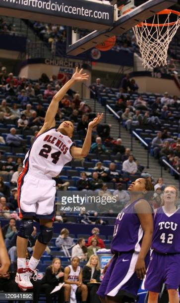 Armintie Price of Ole Miss scoring a layup over TCU defenders in the secondhalf of a firstround game at the Hartford Civic Center in Hartford CT on...