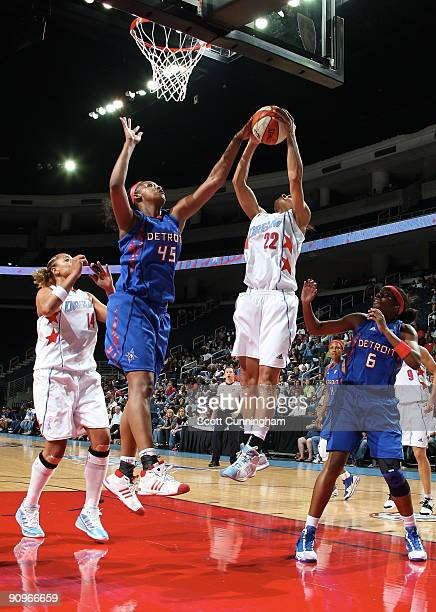 Armintie Price of the Atlanta Dream battles for a rebound during Game 2 of the WNBA Eastern Conference Semifinals against Kara Braxton of the Detroit...