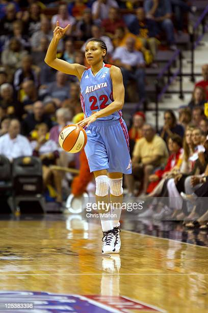 Armintie Price of the Atlanta Dream calls a play against the Connecticut Sun in Game One of the Eastern Conference Semifinals during the 2011 WNBA...