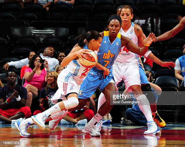 Armintie Price of the Atlanta Dream drives against Eshaya Murphy of the Chicago Sky at Philips Arena on August 22 2012 in Atlanta Georgia NOTE TO...