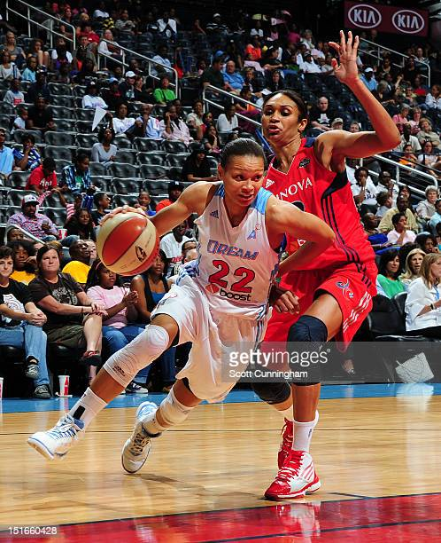 Armintie Price of the Atlanta Dream drives against Iziane Castro Marques # of the Washington Mystics at Philips Arena on September 9 2012 in Atlanta...