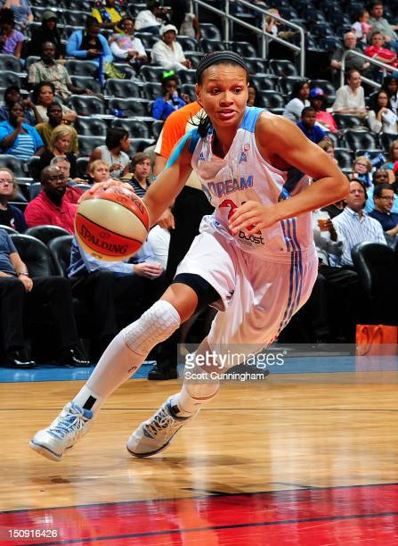 Armintie Price of the Atlanta Dream drives against the Tulsa Shock at Philips Arena on August 28 2012 in Atlanta Georgia NOTE TO USER User expressly...