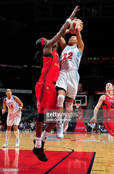 Armintie Price of the Atlanta Dream drives to the basket against Michelle Snow of the Washington Mystics at Philips Arena on August 30 2012 in...
