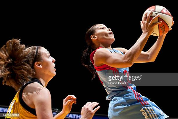 Armintie Price of the Atlanta Dream goes to the basket past Kayla Pedersen of the Tulsa Shock during the WNBA game on June 29 2012 at the BOK Center...