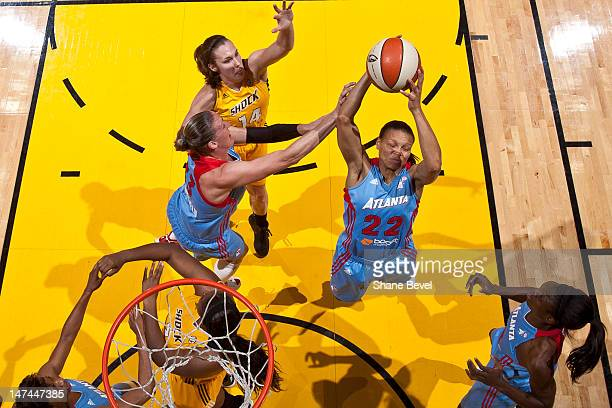 Armintie Price of the Atlanta Dream grabs the rebound against Kayla Pedersen of the Tulsa Shock during the WNBA game on June 29 2012 at the BOK...