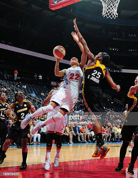 Armintie Price of the Atlanta Dream puts up a shot against Glory Johnson of the Tulsa Shock at Philips Arena on August 28 2012 in Atlanta Georgia...