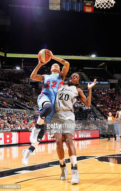 Armintie Price of the Atlanta Dream shoots against Shameka Christon of the San Antonio Silver Stars at the ATT Center on July 13 2012 in San Antonio...