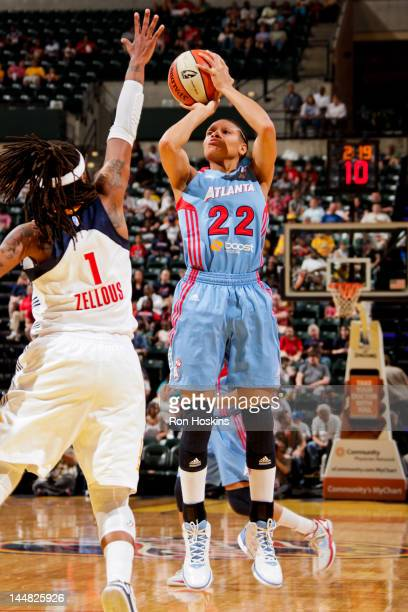 Armintie Price of the Atlanta Dream shoots against Shavonte Zellous of the Indiana Fever at Bankers Life Fieldhouse on May 19 2012 in Indianapolis...