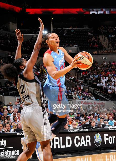 Armintie Price of the Atlanta Dream shoots against Shenise Johnson of the San Antonio Silver Stars at the ATT Center on July 13 2012 in San Antonio...