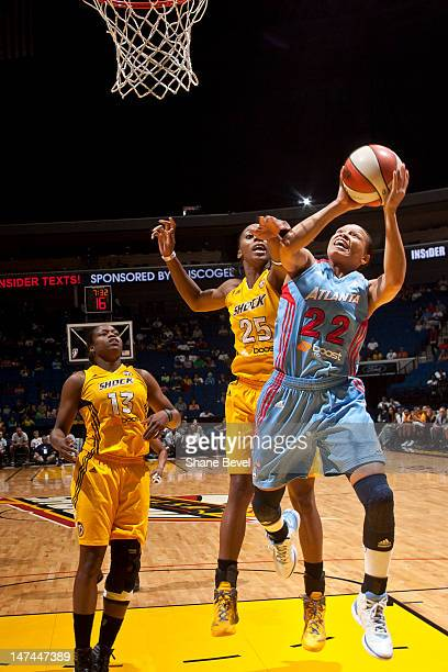 Armintie Price of the Atlanta Dream shoots past Glory Johnson of the Tulsa Shock during the WNBA game on June 29 2012 at the BOK Center in Tulsa...