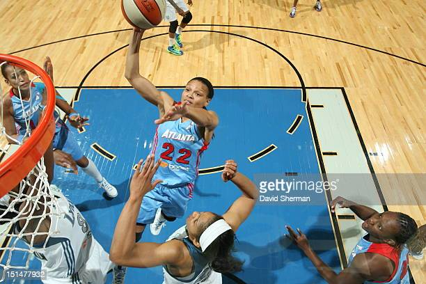 Armintie Price of the Atlanta Dream shoots the ball against Taj McWilliamsFranklin and Maya Moore of the Minnesota Lynx during the WNBA game on...