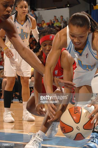 Armintie Price of the Chicago Sky battles with Crystal Smith and Tina Thompson of the Houston Comets for the loose ball at the UIC Pavilion July 29...