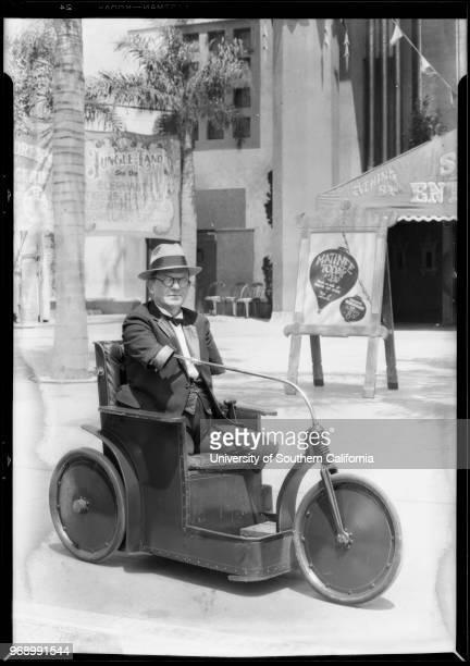 Armless & legless man at Grauman's Chinese Theatre, Los Angeles, California, 1928.