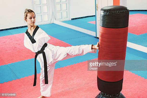 Armless young woman practicing taekwondo