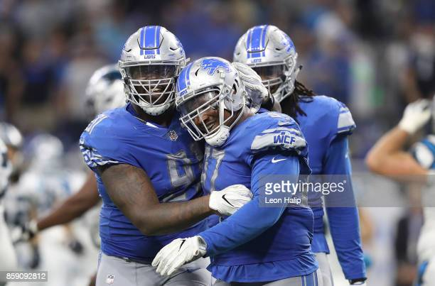 Armonty Bryant and A'Shawn Robinson of the Detroit Lions celebrate a fourth down stop against the Carolina Panthers at Ford Field on October 8 2017...