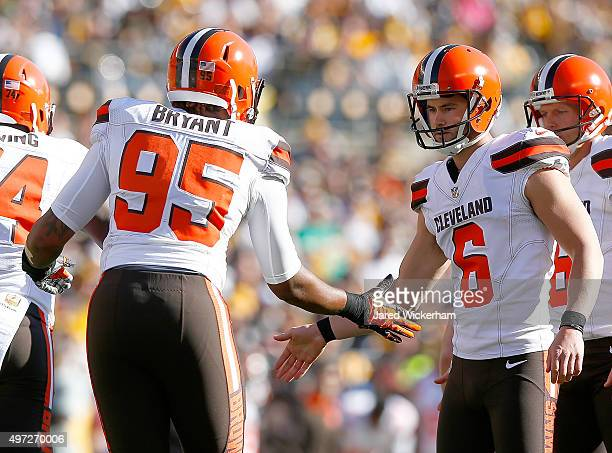Armonty Bryant and Travis Coons of the Cleveland Browns celebrate a 1st quarter field goal made by Coons during the game against the Pittsburgh...