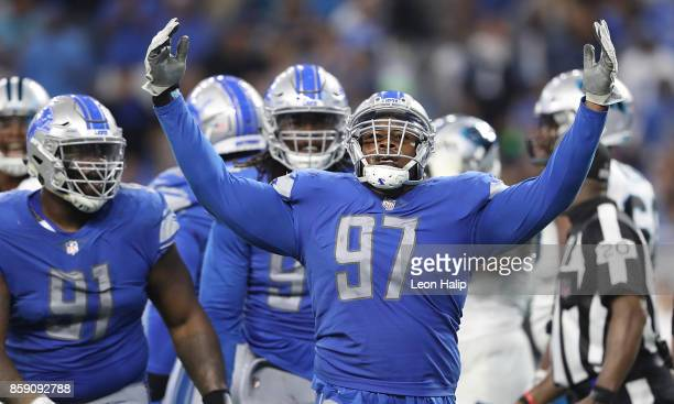 Armonty Bryant celebrates a fourth down stop against the Carolina Panthers at Ford Field on October 8 2017 in Detroit Michigan Carolina defeated...