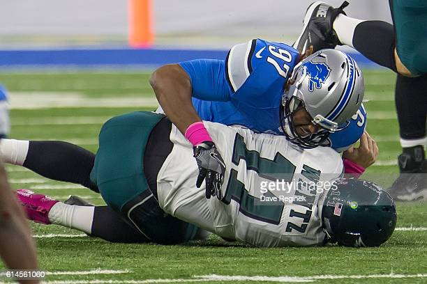Armonty Bryant of the Detroit Lions tackles Carson Wentz of the Philadelphia Eagles during an NFL game at Ford Field on October 9 2016 in Detroit...