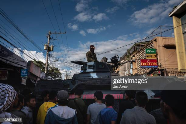 Armored Personel Carriers roll out on a streets at the city center to secure a hotspot polling precinct on January 21 2019 in Cotabato City southern...