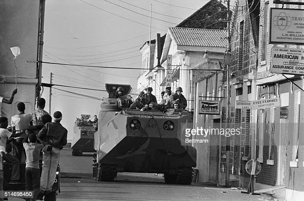 A US armored personnel carrier patrols the streets of St George's Grenada during the Grenada Invasion
