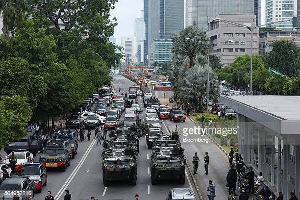 Armored police and military vehicles stand near the site of an explosion in Jakarta Indonesia on Thursday Jan 14 2016 Explosions ripped through...