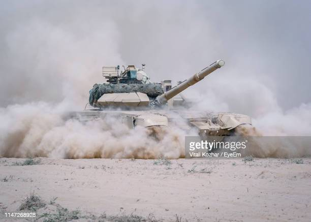 armored tank on dirt land - war stock pictures, royalty-free photos & images
