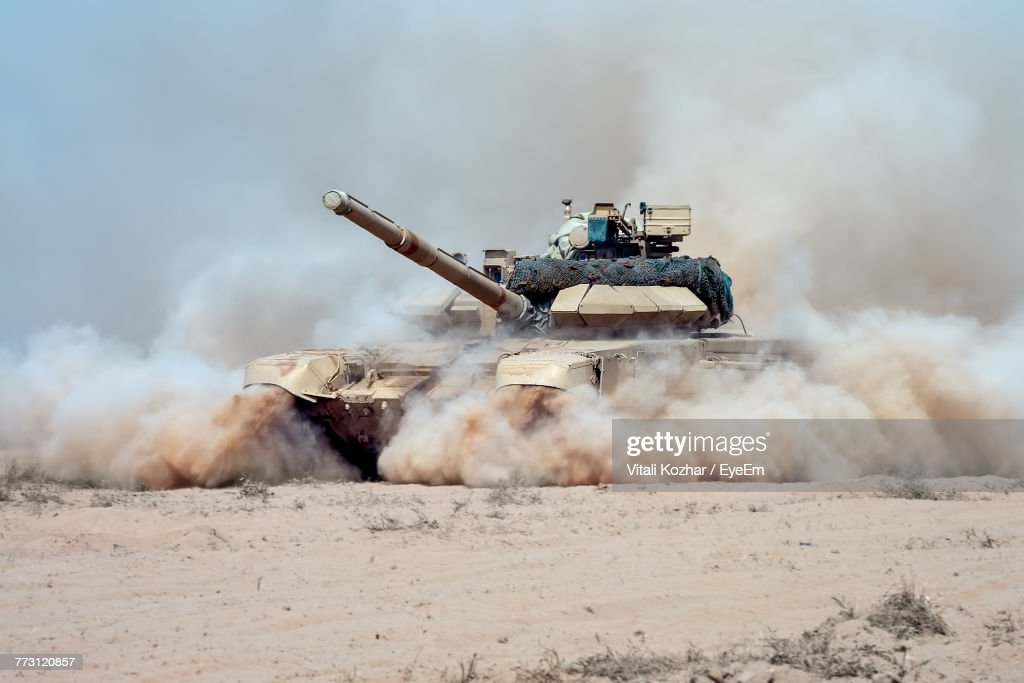 Armored Tank On Dirt Road Against Sky : Stock Photo