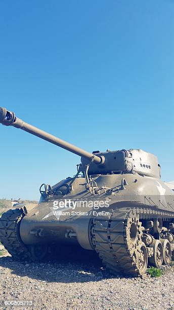 Armored Tank On Field Against Clear Blue Sky