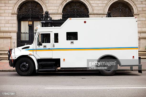 armored truck at bank - armored vehicle stock pictures, royalty-free photos & images