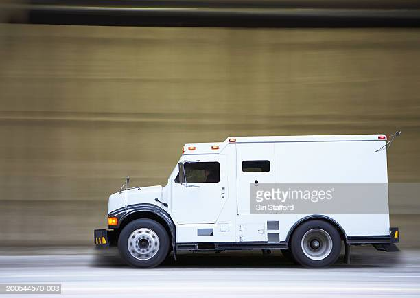 armored truck on city street - armored vehicle stock pictures, royalty-free photos & images