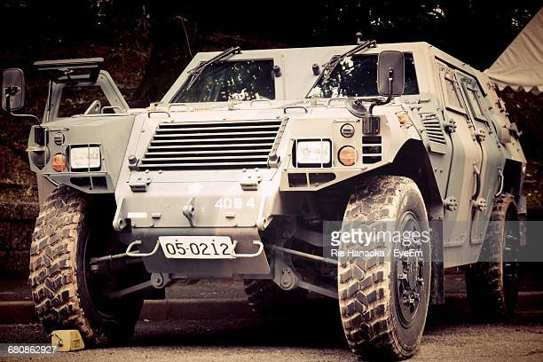 armored vehicle in parking lot - armored vehicle stock pictures, royalty-free photos & images