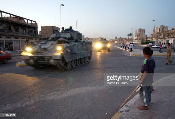 Armored vehicles from the US Army's 1st Armored Division arrive during a raid looking for possible weapons stocks June 23 2003 in the AlshekMaruf...