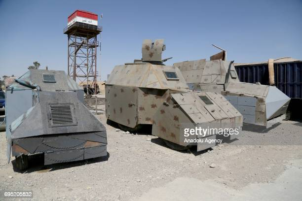 Armored vehicles which were using by Daesh terrorist for the suicide attacks are seen after Iraqi soldiers captured them during the Operation to...