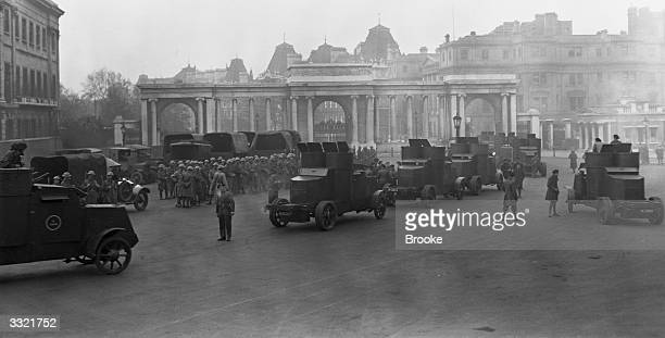 Armoured cars and troops at Hyde Park Corner London preparing to escort London's great food convoy at 6am on the seventh day of the General Strike...