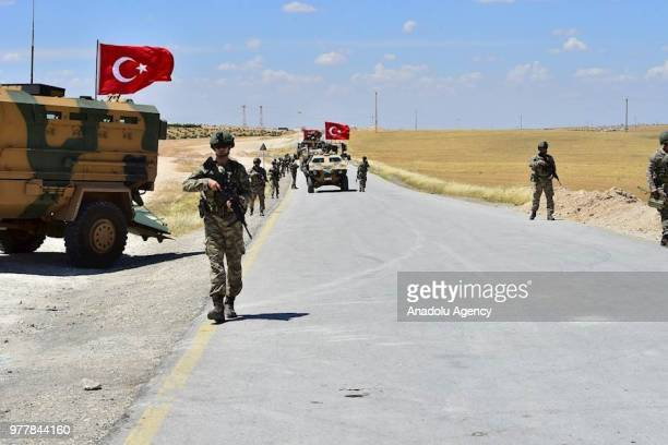 Armoured vehicles and soldiers of Turkish Armed Forces start to patrol between northern Syrian city of Manbij and Turkey's Operation Euphrates Shield...