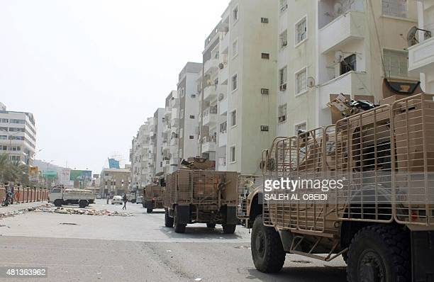 Armoured vehicles belonging to fighters loyal to exiled President Abedrabbo Mansour Hadi drive through a residential neighbourhood in the southern...