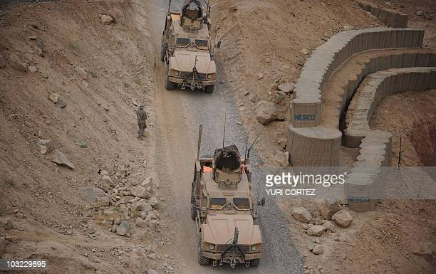 Armoured vehicles from 2nd Brigade Combat Team 101st Airborne Division leave the Arghandab base in Kandahar province on August 3, 2010. Amid growing...
