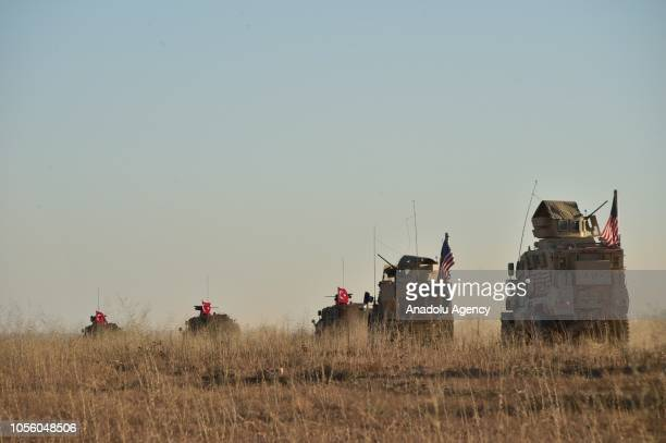 Armoured vehicles of Turkish and US troops are seen as they begin their first round of joint patrols in the northern Syrian city of Manbij as part of...