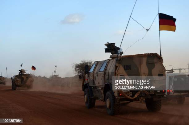 UN armoured vehicles with the German contingent of the United Nations Multidimensional Integrated Stabilisation Mission in Mali patrol the streets of...