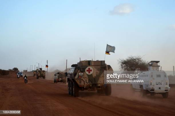 TOPSHOT UN armoured vehicles with the German contingent of the United Nations Multidimensional Integrated Stabilisation Mission in Mali patrol the...