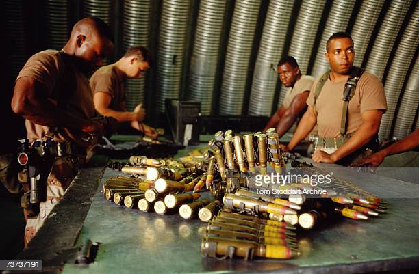 Armourers loading heavy machine gun bullets into belts at Dhahran military airbase Saudi Arabia during the Gulf War December 1990