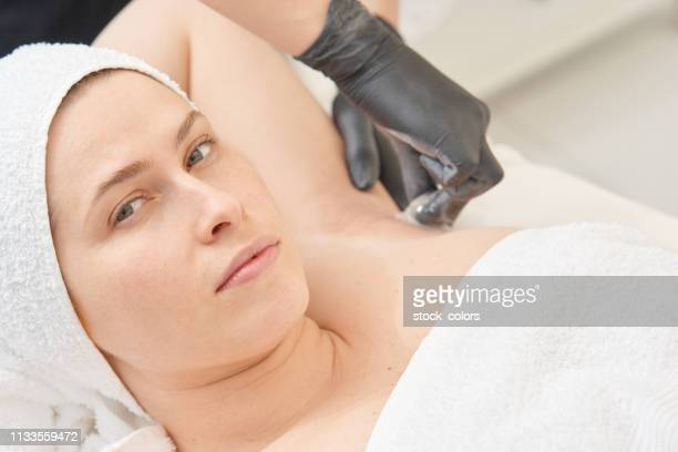 armpit hair removal - armpit hair woman stock pictures, royalty-free photos & images