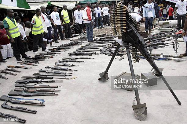 Arms and ammunition surrendered by one of Nigeria's key militant leaders in the volatile oil hub of the Niger Delta Ateke Tom is displayed by...