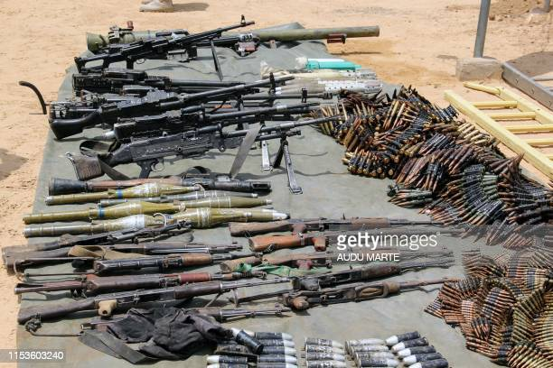 Arms and ammunitions recovered from Boko Haram jihadists are displayed at the headquarters of the 120th Battalion in Goniri, Yobe State, in Nigeria's...