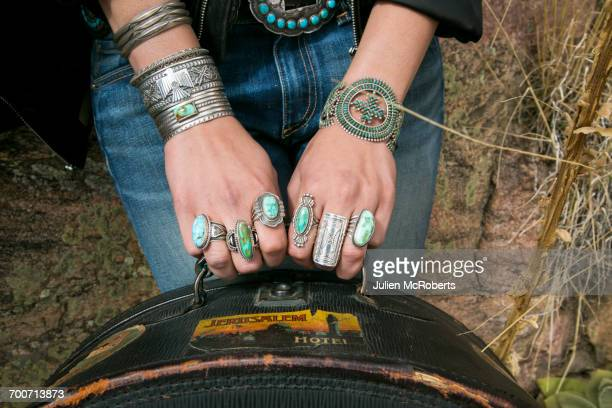 arms and hands of caucasian woman wearing ornate jewelry - santa fe foto e immagini stock