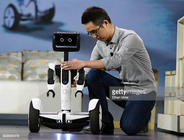 Arms are affixed to a selfbalancing Ninebot Segway personal transportation robot during a keynote address by Intel Corp CEO Brian Krzanich at CES...