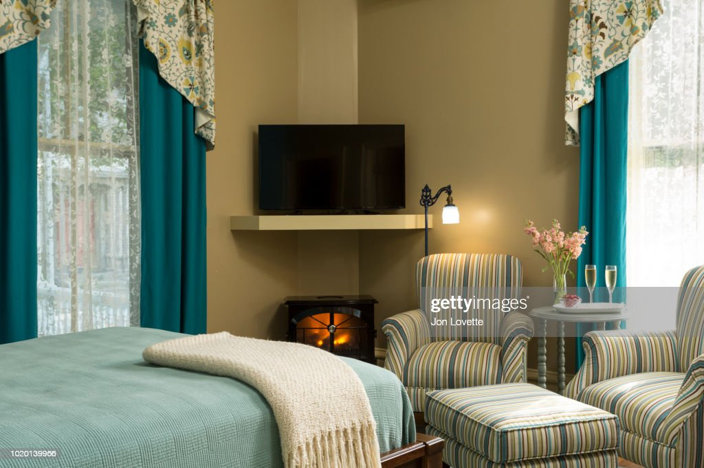 Arms Chairs Champagne And Flowers In Bedroom With Fireplace ...