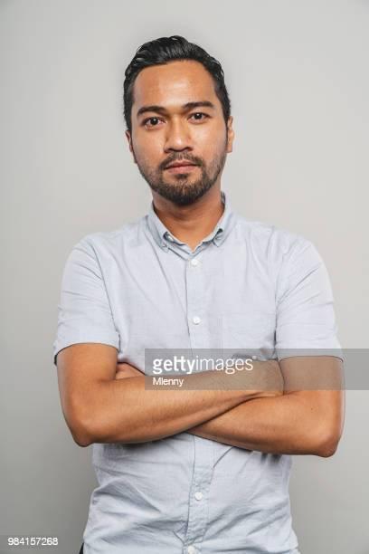 arms crossed malaysian man portrait - braccia incrociate foto e immagini stock