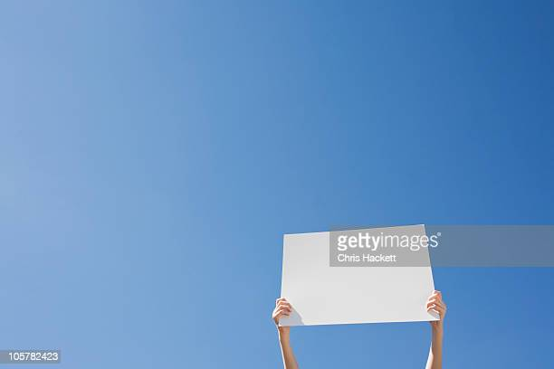 arms holding a blank placard - march stock-fotos und bilder