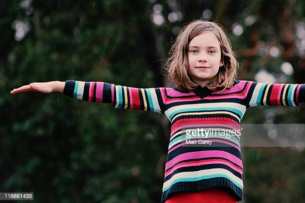 Arms outstretched girl